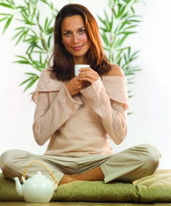 Woman Sitting with Tea Cup